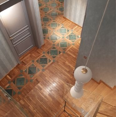 WORKINGS AND COVERINGS IN WOOD, PARQUET, STONE FLOORS, MADE-IN-ITALY